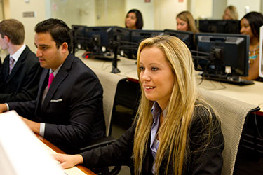 photo of students in the college of business trading room