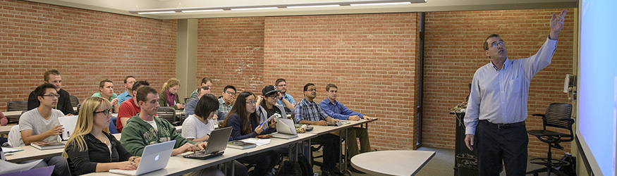 photo of students and a professor in class