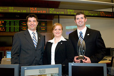photo of business students in the trading room