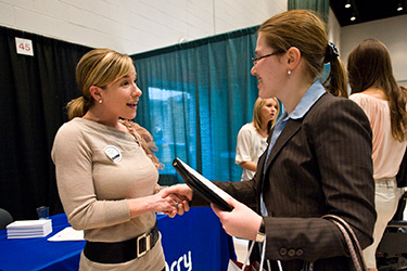 photo of a student and employer at a job fair