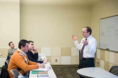 photo of a professor and students in a class